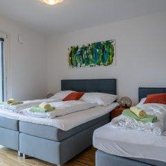 Апартаменты FeelGood Apartments Seestadt Green Living Вена комната для гостей фото 3
