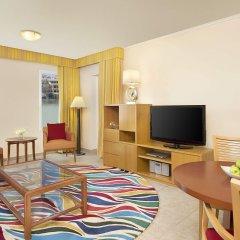 Апартаменты Marriott Executive Apartments Green Community комната для гостей