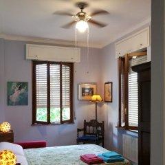 Апартаменты Villa DaVinci - Garden Apartment Вербания комната для гостей