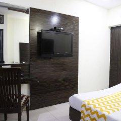 Отель OYO 16011 Hotel Mohan International Индия, Нью-Дели - отзывы, цены и фото номеров - забронировать отель OYO 16011 Hotel Mohan International онлайн удобства в номере