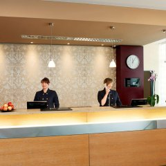 NH Zürich Airport Hotel интерьер отеля