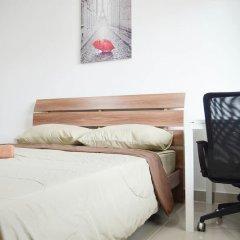 Отель UTD Loft комната для гостей