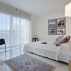 Отель Marvellous Apartment in Tigne Point With Pool Мальта, Слима - отзывы, цены и фото номеров - забронировать отель Marvellous Apartment in Tigne Point With Pool онлайн комната для гостей фото 3