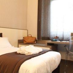Hotel Tiziano Park & Vita Parcour Gruppo Mini Hotel Милан комната для гостей