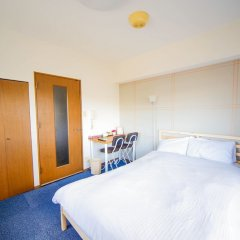 Апартаменты Hakata Apartment Хаката комната для гостей фото 2
