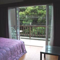 Апартаменты Hill Top Sweet Serviced Apartment Паттайя комната для гостей