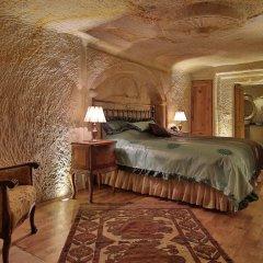 Отель Golden Cave Suites сейф в номере