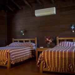 Отель Cañon de la Vieja Lodge Коста-Рика, Sardinal - отзывы, цены и фото номеров - забронировать отель Cañon de la Vieja Lodge онлайн комната для гостей