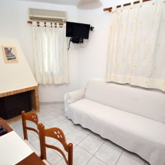 Отель Koukounari Apartments Греция, Агистри - отзывы, цены и фото номеров - забронировать отель Koukounari Apartments онлайн комната для гостей фото 4