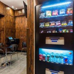 Отель Americana Inn банкомат