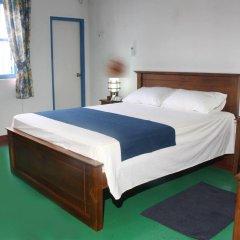 Отель Villa Whispering Shells комната для гостей
