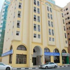 Отель Al Buhairah Hotel Apartments ОАЭ, Шарджа - отзывы, цены и фото номеров - забронировать отель Al Buhairah Hotel Apartments онлайн вид на фасад