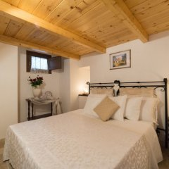 Отель Trulli Family Альберобелло комната для гостей фото 5