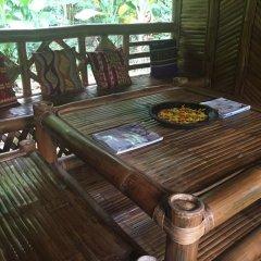 Отель Bamboo Rooms & Cottages by Dang Maria BB Филиппины, Пуэрто-Принцеса - отзывы, цены и фото номеров - забронировать отель Bamboo Rooms & Cottages by Dang Maria BB онлайн балкон