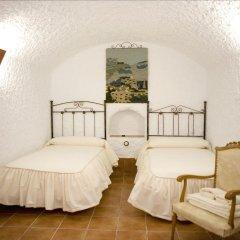 Отель Cuevalia. Alojamiento Rural En Cueva Сьерра-Невада комната для гостей фото 3