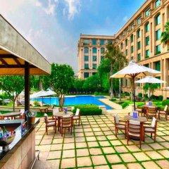 Отель The Grand New Delhi бассейн фото 2