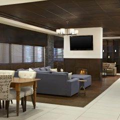 Отель Four Points by Sheraton Hotel & Suites Calgary West Канада, Калгари - отзывы, цены и фото номеров - забронировать отель Four Points by Sheraton Hotel & Suites Calgary West онлайн интерьер отеля