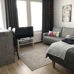 Апартаменты The Harbour Apartments Ювяскюля комната для гостей