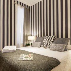 Отель Apartamentos Casa Malasaña Испания, Мадрид - отзывы, цены и фото номеров - забронировать отель Apartamentos Casa Malasaña онлайн комната для гостей
