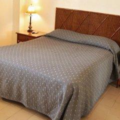 Отель Aparta Hotel Turey Доминикана, Санто Доминго - отзывы, цены и фото номеров - забронировать отель Aparta Hotel Turey онлайн комната для гостей