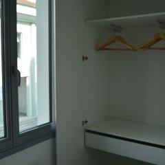 Отель Le Matisse сейф в номере