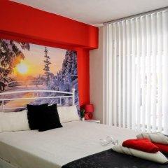 Отель Athens Plaza Luxury Apartments Греция, Афины - отзывы, цены и фото номеров - забронировать отель Athens Plaza Luxury Apartments онлайн комната для гостей фото 2