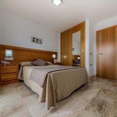 Отель Apartamentos Loto Conil Испания, Кониль-де-ла-Фронтера - отзывы, цены и фото номеров - забронировать отель Apartamentos Loto Conil онлайн комната для гостей