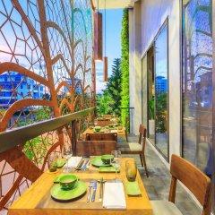 Отель ÊMM Hotel Hue Вьетнам, Хюэ - отзывы, цены и фото номеров - забронировать отель ÊMM Hotel Hue онлайн балкон