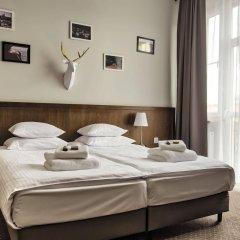 Отель Daniel Griffin Aparthotel by Artery Hotels Польша, Краков - 2 отзыва об отеле, цены и фото номеров - забронировать отель Daniel Griffin Aparthotel by Artery Hotels онлайн комната для гостей фото 5