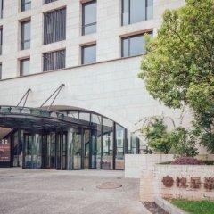 Hangzhou Xixi Paradise Yueju Hotel вид на фасад фото 2