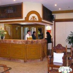 Отель Citadel Inn Makati Филиппины, Макати - отзывы, цены и фото номеров - забронировать отель Citadel Inn Makati онлайн интерьер отеля