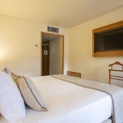 Отель Comfort Inn Ponta Delgada Португалия, Понта-Делгада - отзывы, цены и фото номеров - забронировать отель Comfort Inn Ponta Delgada онлайн удобства в номере фото 2