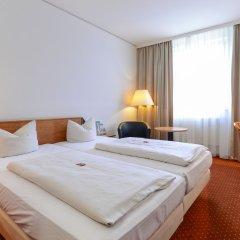 Отель NOVINA HOTEL Südwestpark Nürnberg Германия, Нюрнберг - 1 отзыв об отеле, цены и фото номеров - забронировать отель NOVINA HOTEL Südwestpark Nürnberg онлайн комната для гостей фото 4