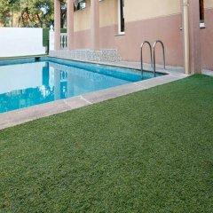 Отель Escala Suites бассейн
