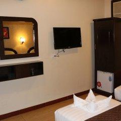Grand Sina Hotel сейф в номере