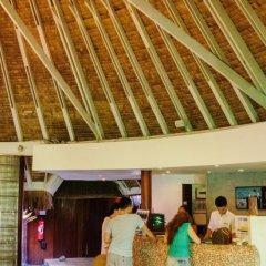Отель Sofitel Bora Bora Marara Beach Resort Французская Полинезия, Бора-Бора - отзывы, цены и фото номеров - забронировать отель Sofitel Bora Bora Marara Beach Resort онлайн интерьер отеля