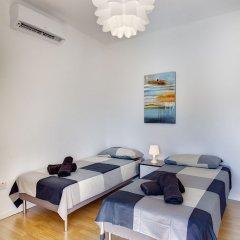 Отель Modern 2 Bedroom Seaview Apartment Мальта, Слима - отзывы, цены и фото номеров - забронировать отель Modern 2 Bedroom Seaview Apartment онлайн комната для гостей фото 5
