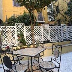 Апартаменты Santi Quattro Apartment & Rooms - Colosseo