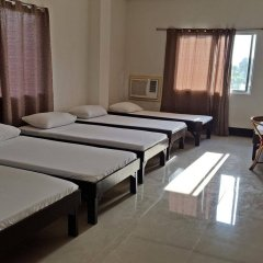 Отель La Chari'ca Inn Филиппины, Пуэрто-Принцеса - отзывы, цены и фото номеров - забронировать отель La Chari'ca Inn онлайн комната для гостей фото 4