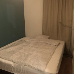 Апартаменты Kvadraturen Apartments Family Кристиансанд комната для гостей фото 4