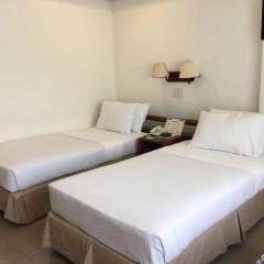 Отель Soledad Suites Филиппины, Тагбиларан - отзывы, цены и фото номеров - забронировать отель Soledad Suites онлайн комната для гостей фото 2