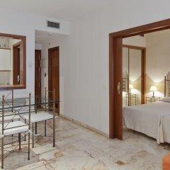 Отель Apartamentos Vértice Bib Rambla Испания, Севилья - отзывы, цены и фото номеров - забронировать отель Apartamentos Vértice Bib Rambla онлайн комната для гостей