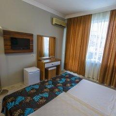 Litore Resort Hotel & Spa Турция, Окурджалар - отзывы, цены и фото номеров - забронировать отель Litore Resort Hotel & Spa - All Inclusive онлайн удобства в номере