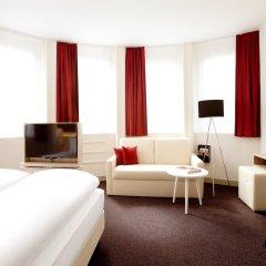 Отель Vienna House Easy München Германия, Мюнхен - 1 отзыв об отеле, цены и фото номеров - забронировать отель Vienna House Easy München онлайн комната для гостей фото 5