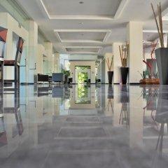 Отель Oasis Palm Hotel Мексика, Канкун - 9 отзывов об отеле, цены и фото номеров - забронировать отель Oasis Palm Hotel онлайн интерьер отеля фото 3