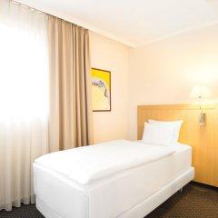 NH Zürich Airport Hotel комната для гостей