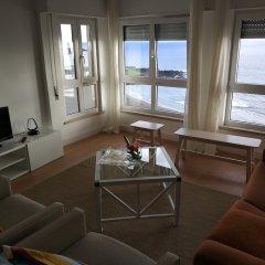 Апартаменты Lila Beach Apartment Понта-Делгада комната для гостей фото 5