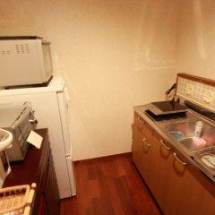 Отель Cottage Hakuraku Центр Окинавы ванная