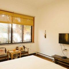 Отель Suzhou Tai Lake Pur-land Inn удобства в номере фото 2