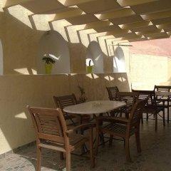 Отель Anemomilos Suites Греция, Остров Санторини - отзывы, цены и фото номеров - забронировать отель Anemomilos Suites онлайн питание